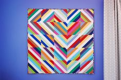 My Seattle Quilty Beeings charity group and I had the opportunity to play with simple string blocks a few months ago.  I moved them around on the design wall before I left and the layout that stuck…