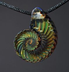 Beautiful creations with borosilicate glass, Everything from pendants, rings, artglass, lampwork beads, and sculpture.
