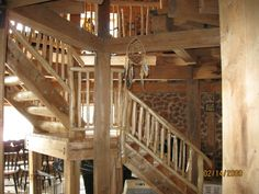 round cordwood house...interior....great beams and stairs !