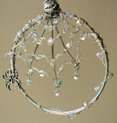 tutorial -Jeweled spider web wire - LOVE!. (She said it was tricky and 2.5 hours to do. A bangle was used and it's a great suncatcher.)