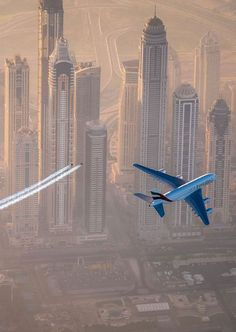 Jetman Dubai & the ultimate formation flight. Click the link on our bio to watch the video! Hit the link on bio for the making of ;) by militarytopics Airbus A380, Emirates A380, Dubai, Perfect Timing, Skydiving, Skyscraper, Aviation, In This Moment, Airplane
