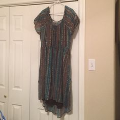 Maurice's size 2 (20-22) NWOT Maurice's size 2 (20-22) NWOT. Blue-green & brown with sequins. Very pretty dress. Never worn or washed. True to size. Shorter in the front & longer in the back. Very cute with boots. Maurices Dresses High Low