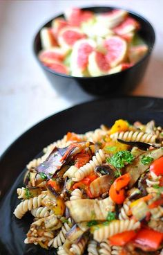 End of summer pasta salad  180g whole-wheat fusilli  2 small eggplants  2 peppers (yellow or red)  2 big tomatoes  8-10 mushrooms    5 tbsp chopped basil and parsley    Oil, salt and pepper to taste    Instructions: