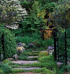 Stepping stones to tranquility, imagine a small chair tucked in amongst the plants, perfect to nestle into with a good book.