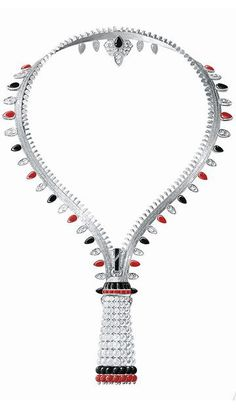 The Zip necklace by Van Cleef & Arpels, genuine emblem of the house since 1951, is seen adorned with onyx, coral, pearls and diamonds. Always convertible, it can be worn as a necklace or a bracelet closed. Other pieces in this collection are no exception. Breath rings and other earrings pompoms detachable rival technique and beauty