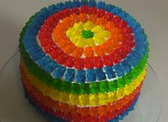 Gorgeous Gummy Bear Pinata Cake / Gummy bears are perfect anytime, but a cake that is decorated in rainbow swirls of gummies and then filled with the same; That's a  treat made in heaven.