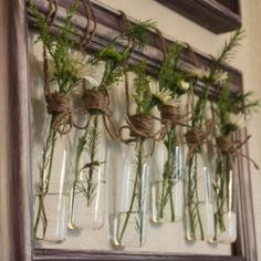 All you need to make wall vases are a few old frames, some paint, twine, and trinkets!