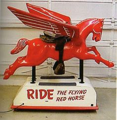 1950 -  Is this beautiful or what? RIDE THE FLYING RED HORSE (Reportedly only five were ever made. Mobil Gas Coin-Operated Pegasus Ride)