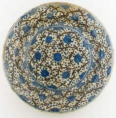 "A FINE NORTH PERSIAN KUBACHI POTTERY DISH 13"" diameter x 2 ½"" depth Blue and white Persian ware was produced in the Timurid era (1370-1502) under the influence of imported Chinese porcelain Glass Ceramic, Ceramic Plates, Flower Images Hd, Ancient Persia, Pottery Art, Pottery Clay, Islamic Art, Colorful Interiors, Islam Beliefs"