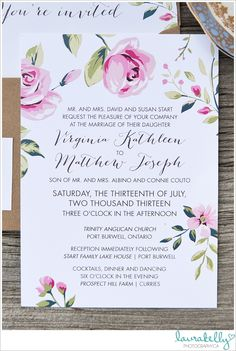 Custom floral wedding invitations lend a feeling of hand-drawn fancy.