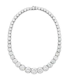 A DIAMOND RIVIERE NECKLACE Designed as a graduated series of forty-nine circular-cut diamonds, the five largest diamonds weighing approximately 9.77, 7.34, 6.43, 5.29 and 4.99 carats, 15 1/2 ins., mounted in platinum