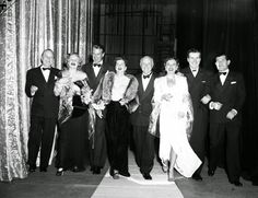 "Cecil B. DeMille, center, is surrounded by the Hollywood actors starring in his film ""North West Mounted Police"" during the film's premiere at the Chicago Theatre and the State-Lake Theater in Chicago on Oct. 24, 1940. Madeleine Carroll, second from left, and Gary Cooper, third from left, play the lead roles in the film. Paulette Goddard, third from right, and Robert Preston, second from right, co-star in the film. Actor Lynne Overman is on the far left."