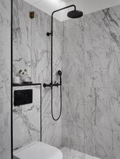 marble, black faucet and brass details