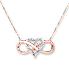 An infinity symbol intertwines with a heart decorated in round diamonds in this lovely 10K rose gold necklace for her. The pendant is suspended from an 18-inch rope chain that secures with a spring ring clasp. The necklace has a total diamond weight of 1/10 carat. Diamond Total Carat Weight may range from .085 - .11 carats.