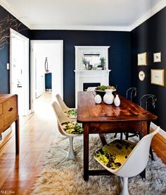 I love the idea of dark dining room walls between rooms with white walls.