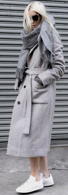 Her tortoise print sunglasses and white sneakers give the varying shades of grey a casual cool touch. |All Everything Gray Winter Street Style | Le Fashion