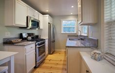 "Cottage Kitchen with Simple Granite, Golden Opportunity 3-1/4"" Solid Red Oak Flooring in Rustic Natural by Shaw Floors"