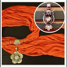 """NEW🎉ORANGE SCARF W/FLOWER & OWL PENDANT BUNDLE NEW! JEWELRY SCARF BUNDLE contains 2 items. Light weight, burnt ORANGE SCARF w/silver flower charm. Drapes softly around neck & dresses up any outfit.   OWL JEWELRY PENDANT. Shiny silver w/black rhinestone accents & large rhinestone center. Charm measures 3 1/2"""" long & 1 1/2"""" wide. Slide onto this or any scarf to add some shine! Pendants are interchangeable! Accessories Scarves & Wraps"""