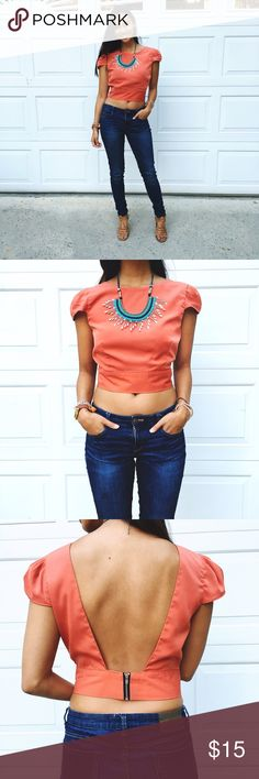 "Tangerine Skies • Crop Top The Tangerine Sky Crop Top features:  - Jewel Neckline - Adorable short puff sleeves - Crop cut - Open plunge back  - 3"" back zipper Made with 100% Polyester. Made in the U.S. Pair with some high waisted jeans or shorts and top with cute wedges and a statement necklace! In perfect condition. Top is a little big on me so I had some clips holding it tight in the picture. But it's true to size and fits well for Mediums. Size= Medium  Shoulder= 13.5"" Sleeve= 5""…"