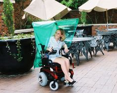 An automatic umbrella or rain cover that attaches to a powered wheelchair and operates with the flip of a switch. Wheelchair Photography, Handicap Ramps, Cartoon Pics, Cartoon Picture, Mobiles, Quadriplegic, Wheelchair Accessories, Automatic Umbrella, Powered Wheelchair