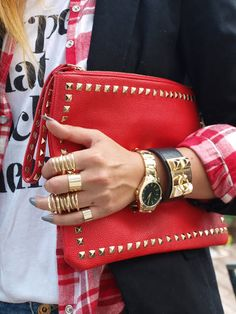 red with gold accessories. Red leather clutch with golden studs