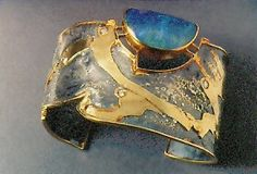 silver and gold bracelet with labradorite by American studio artist Marne Ryan; Love! The labradorite looks like opal.