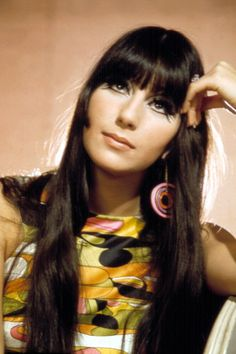 Cher  With her blunt bangs, kohl-rimmed eyes and love of outlandish prints and the widest of flared trousers, Cher was a certified 60s icon. The then other half of Sonny and Cher led the way with the bold and the daring, and launched the hippie look with cool Californian style.