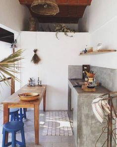 Apartment in Sayulita, Mexico. Light filled studio apartment in town. Steps  from the shops and beach in the day, and dining and dancing at night.  With it's walls of windows this space offers excellent people watching from a second story perch.