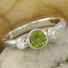 Peridot and White Sapphire 3 Stone Sterling Silver 925 Ring  Peridot and sapphire for both our birthdays according to Zodiac