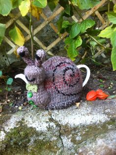 Snail out on the town tea cosy