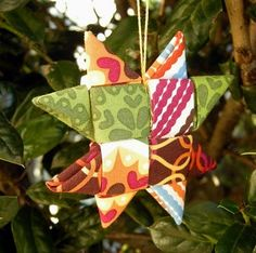 Folded Fabric Star Ornament Tutorial  http://blog.betzwhite.com/2011/12/fabric-star-ornament-tutorial.html