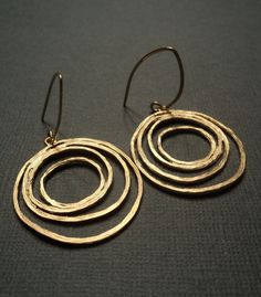 Gold circle dangles on brass ear wires.  Earrings.  Circles.  Geometric.  Modern.  Abstract.  Contemporary.