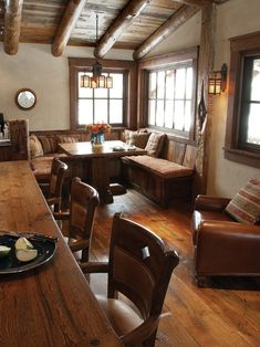This ski cabin�s breakfast nook with built-in bench seating is the perfect spot for a quick meal before a busy day on the slopes. The wood floors, wood-beamed ceiling and wood kitchen countertops all enhance the room's rustic feel, while an Arts and Crafts-style chandelier and sconces illuminate the space.