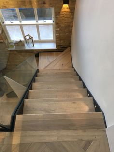 Steel staircase with timber treads and frameless glass balustrade