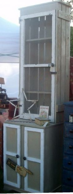 The bottom is an old TV cabinet.  The rest shutters and a screen (from Past Blessings on Junkmarket Style)