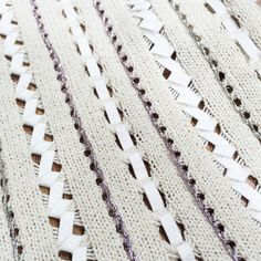 "2016 Spin Expo Swatches pattern - Dropped stitches ""sewn"" up with ribbon and metallic yarn. Neat idea!"