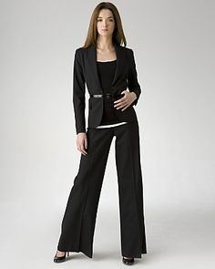 Deep V necks with minimal or no lapels are great for women with ample curves. The belt highlights the waist. The wide pant legs create a more symmetrical look.