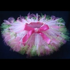 Tutu - absolutely gorgeous.  Love the extra tied ribbons and tule at the bottom of the tutu lengths!  So need to have a few like this!