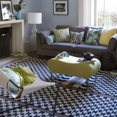 One significant chair and ottoman, neutral sofa and interesting area rug.