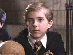 "Louis Doyle plays Ernie McMillan.  When McGonagall addresses the students in the Great Hall about Voldemort demanding Harry's surrender and the urgent need to evacuate, Ernie shouts, ""And what if we want to stay and fight?"", which rallies the older students to join the Battle of Hogwarts. During the battle, he, Luna, and Seamus help Harry fight the Dementors by conjuring their respective Patronuses; Ernie's takes the form of a boar."