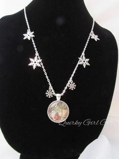 "Christmas Holiday 24"" Necklace with Santa Claus pendant and silver snowflakes - pinned by pin4etsy.com"