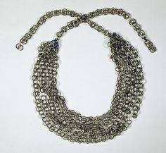 Glass necklace by the Innsbruck Court Glassworks ca. 1570-1591. In total, it is 55cm long, and each ring is only 1cm in diameter. Made up of 6 strands, the ends held together by a ring of blue or green glass, and a blue glass closure-ring. The individual elements are alternate 1 white and 2 black, and 2 white and 1 black. (Some rings are missing, and one of the six chains is broken.) Kunsthistorisches Museum Wien, Sammlungen Schloss Ambras.