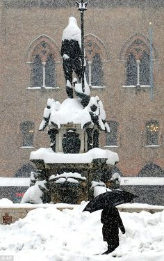 The Nettuno fountain is covered by snow in downtown Rome, Italy