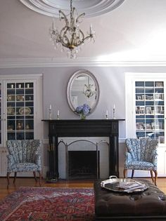 """This paint color is just light enough to be airy and gray at the same time.  She says it's a """"custom mix from Benjamin Moore to match a ballroom at the Lyman Estate in Waltham."""""""