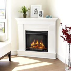 The Real Flame Chateau Corner Electric Fireplace is the perfect decoration for your living room. The realistic LED flames will create a warm and inviting ambience while the mantel's classic design lets it blend seamlessly into any setting. Tv Stand With Fireplace Lowes, Electric Fireplace With Mantel, Electric Fireplace Reviews, Corner Gas Fireplace, White Fireplace, Modern Fireplace, Fireplace Design, Fireplace Mantels, Fireplace Ideas