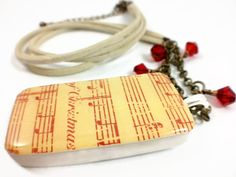 Christmas Song Domino Necklace with beige cord, antique gold chain & red Swarovski beads.  $25.00