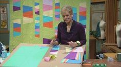 """Watch """"Sewing With Use Nancy's quick method to make the time-honored Tumbling Tumblers block—turning a traditional quilt into a modern one. Learn to audition fabric, use templates, and stitch with ease! Create a speedy column quilted table runner using hexagon shapes with a template that eliminates the dreaded Y-seam—it's fast!"""