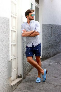 Make a baby blue button-down shirt and dark blue shorts your outfit choice for an easy to wear, everyday look. Feeling inventive? Complement your outfit with baby blue leather tassel loafers.  Shop this look for $305:  http://lookastic.com/men/looks/navy-shorts-and-light-blue-leather-tassel-loafers-and-light-blue-longsleeve-shirt/409  — Navy Shorts  — Light Blue Leather Tassel Loafers  — Light Blue Longsleeve Shirt
