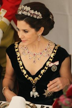 Crown Princess Mary is wearing one of my favourite tiaras here. The Ruby Parure Tiara. This tiara belonged to Crown Prince Frederik's grandmother, Queen Ingrid. The set has a necklace, earrings, brooch and a ring. (Source) It has a long and interesting history with the Danish Royal Family - You can read more about that here.: