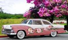 Love the white walls on this classic - not to mention the beautiful painted roses.